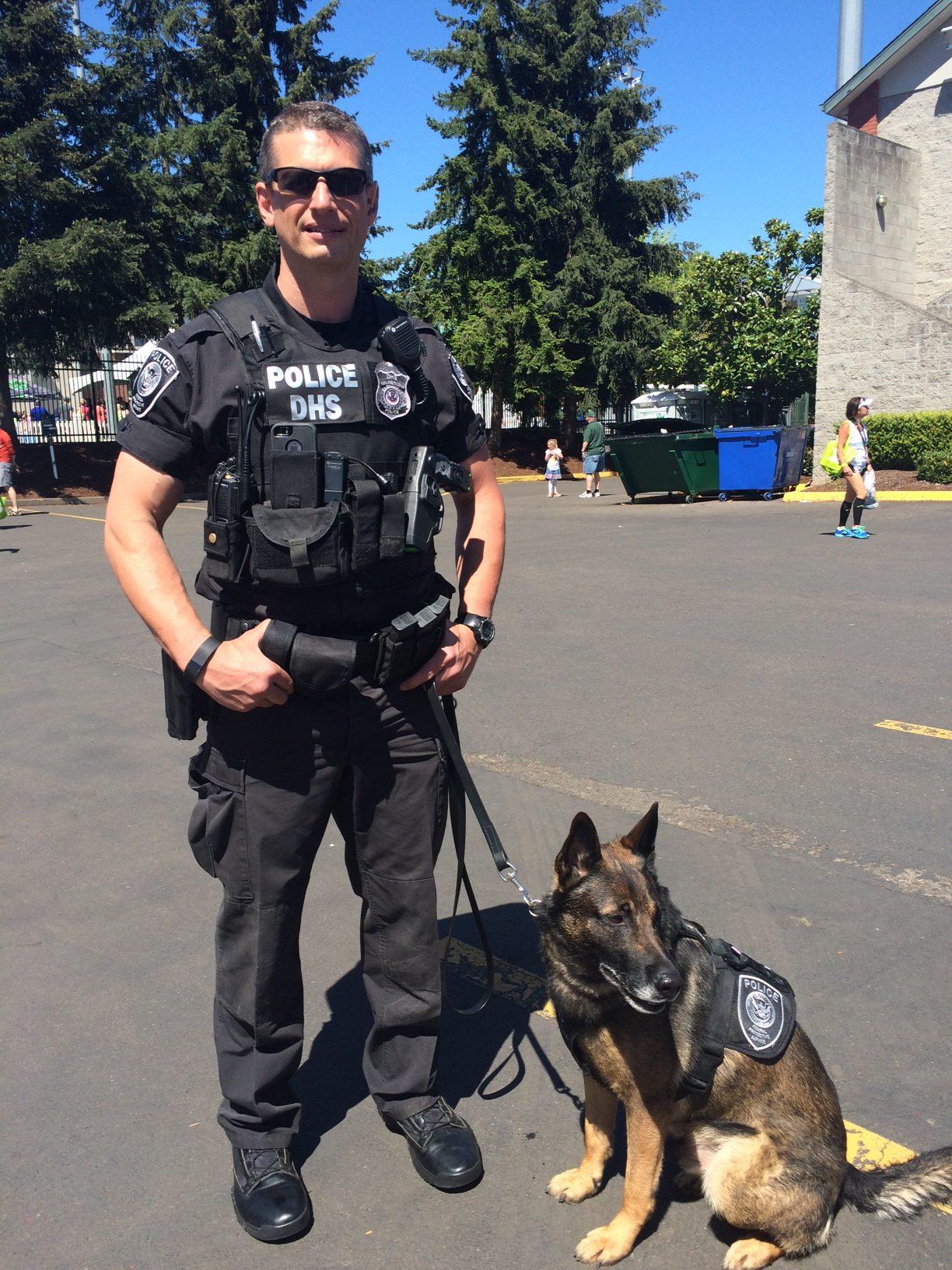 William Turner, Homeland Security, with K9 Cheeto, monitoring the Eugene Marathon, Oregon, 2016